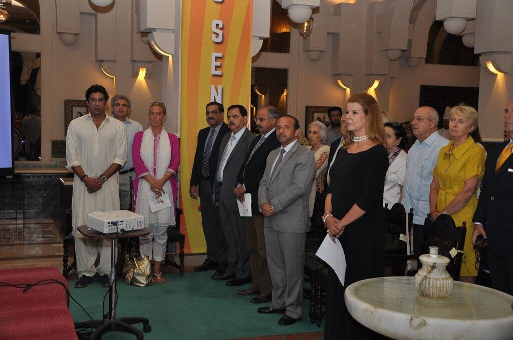 Guests including Wasim Akram & wife  standing for national anthem at launch event of KKAWF in Islamabad